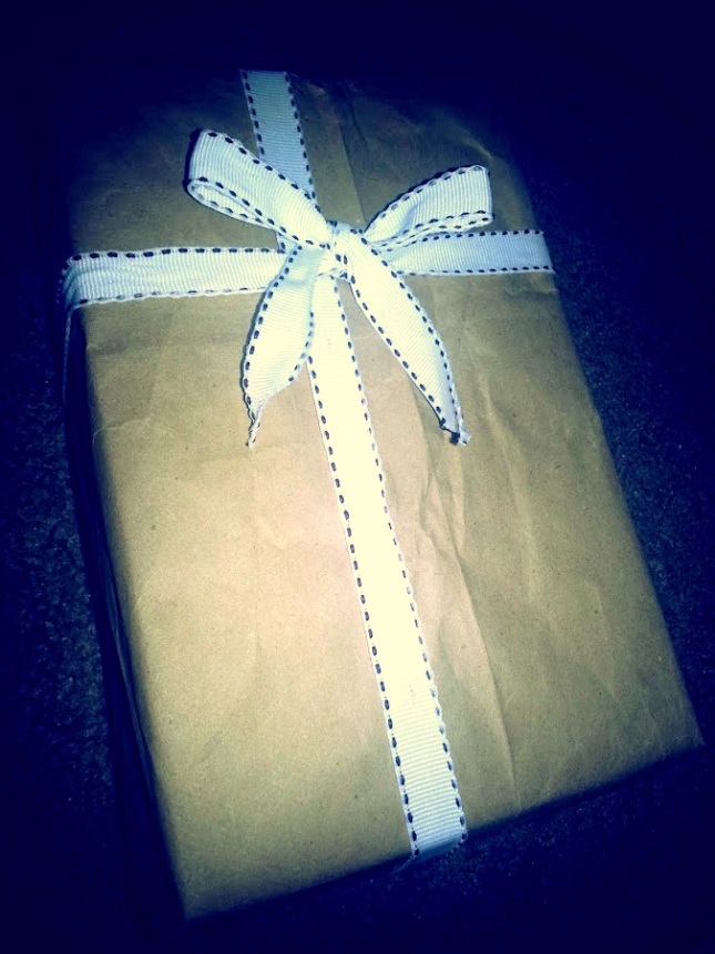 My recycled brown paper bag, that I turned into a rough, gift wrap for a gentlemen's gift (The Crown Royal bottle).