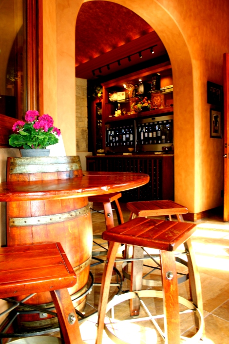 Have a seat, and enjoy your sample, or glasses of wine.