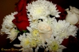 Lovely Floral Arrangements, the wedding was red, white, and black themed.